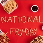"Fries are placed on a red background and are used to spell out ""National Fry Day"""